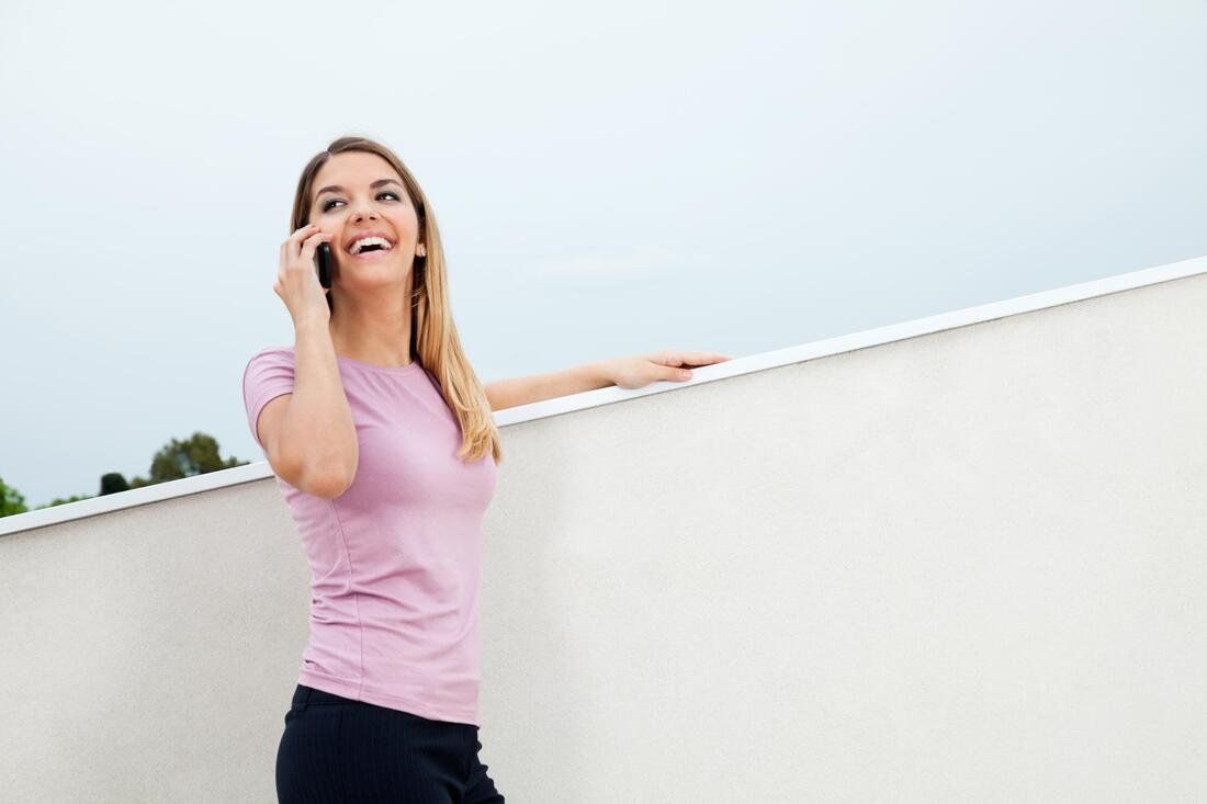 woman smile taking phone call